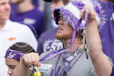 A K-State fan jingles his keys during the game between K-State and Oklahoma State in Bill Snyder Family Stadium on Nov. 5, 2016. (George Walker | The Collegian)