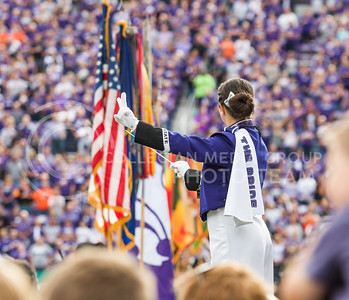 A drum major from The Pride of Wildcat Land conducts the pregame show of the football game between K-State and Oklahoma State in Bill Snyder Family Stadium on Nov. 5, 2016. (John Benfer | The Collegian)