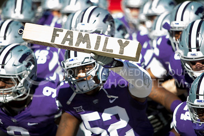 Kansas State football players prepare to take the field at the start of the football game between K-State and Texas in Bill Snyder Family Stadium on Oct. 22, 2016. (Emily Starkey | The Collegian)