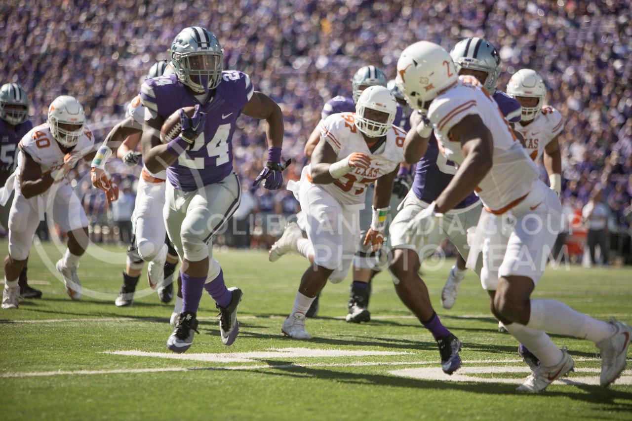 Senior running back Charles Jones carries the ball during the football game between K-State and Texas in Bill Snyder Family Stadium on Oct. 22, 2016. (Emily Starkey | The Collegian)