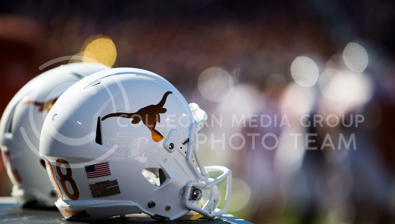 Texas football helmets sit on the sideline during the football game between K-State and Texas in Bill Snyder Family Stadium on Oct. 22, 2016. (Emily Starkey | The Collegian)