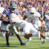Sophomore wide receiver Byron Pringle is tackled during the football game between K-State and Texas in Bill Snyder Family Stadium on Oct. 22, 2016. (Emily Starkey | The Collegian)