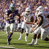 Senior running back Charles Jones runs the ball during the football game between K-State and Texas in Bill Snyder Family Stadium on Oct. 22, 2016. (Emily Starkey | The Collegian)