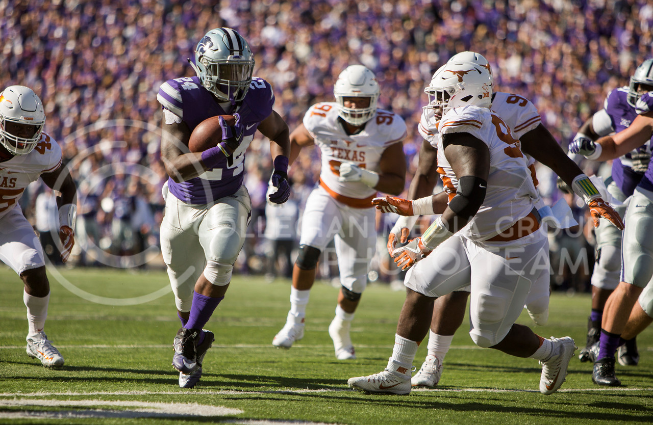 Senior running back Charles Jones runs the ball during the football game between K-State and Texas in Bill Snyder Family Stadium on Oct. 22, 2016. (Emily Starkey   The Collegian)