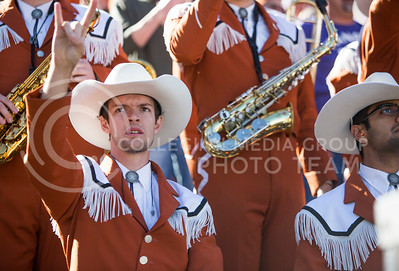 A Texas band member makes the longhorn hand symbol during the football game between K-State and Texas in Bill Snyder Family Stadium on Oct. 22, 2016. (Emily Starkey | The Collegian)