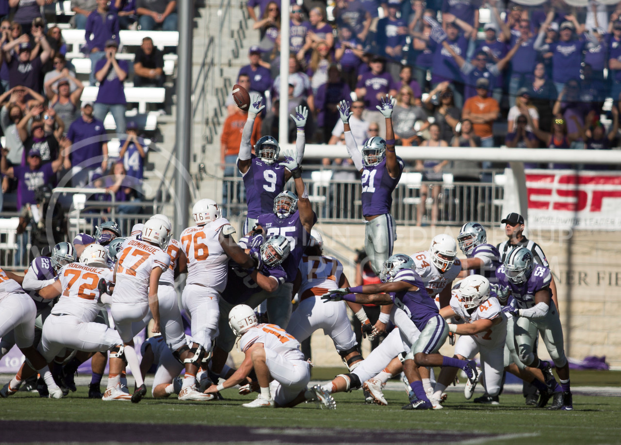 Kansas State defensive players try to block a field goal attempt during the football game between K-State and Texas in Bill Snyder Family Stadium on Oct. 22, 2016. (Emily Starkey   The Collegian)