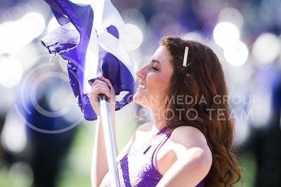 A member of the K-State color guard performs during the pregame show of the football game between K-State and Texas in Bill Snyder Family Stadium on Oct. 22, 2016. (Meg Shearer | The Collegian)
