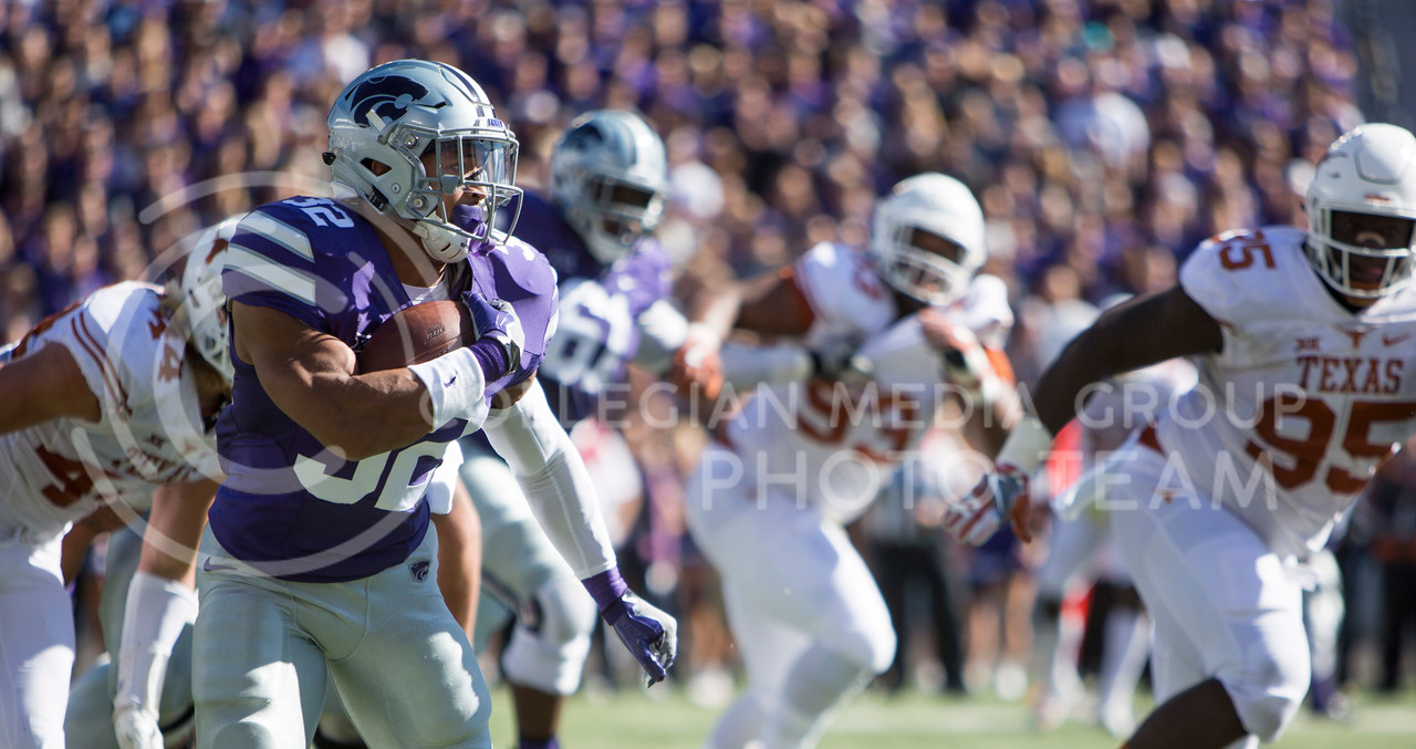 Sophomore running back Justin Silmon runs the ball during the football game between K-State and Texas in Bill Snyder Family Stadium on Oct. 22, 2016. (Emily Starkey | The Collegian)
