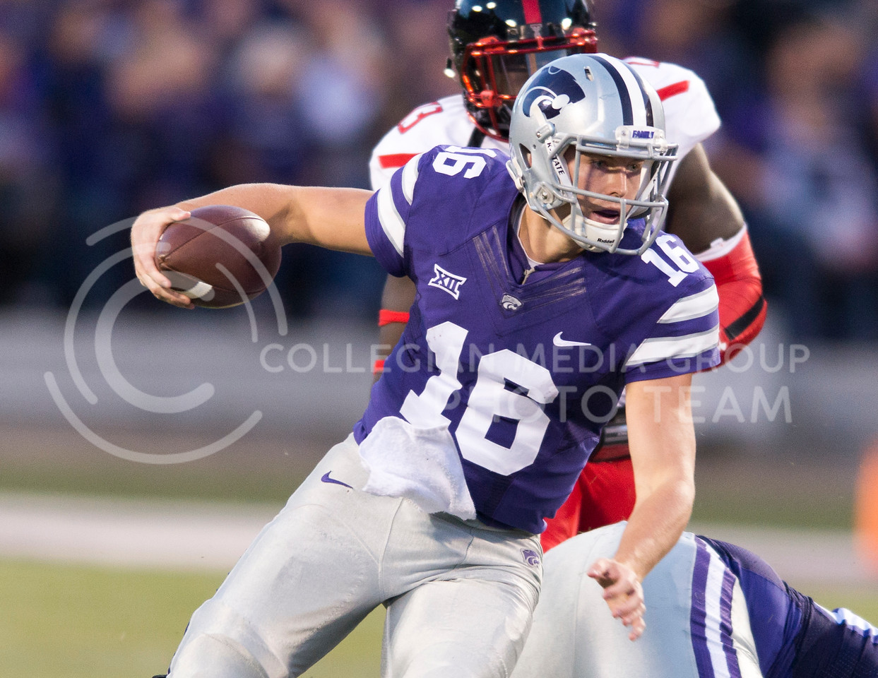 Junior quarterback Jesse Ertz takes the ball downfield during the game between K-State and Texas Tech on Oct. 8, 2016, in Bill Snyder Family Stadium. (George Walker | The Collegian)