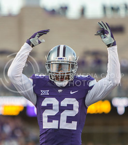 Senior defensive back Dante Barnett motions for the crowd to get louder on a third down during the football game between K-State and Texas Tech on Oct. 8, 2016, in Bill Snyder Family Stadium. (Emily Starkey | The Collegian)