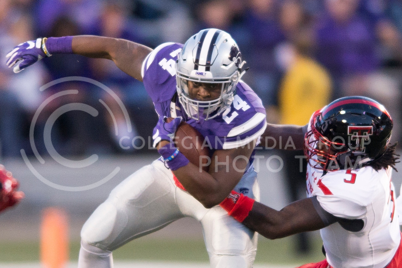 Senior running back Charles Jones pushes through a Texas Tech tackle during the game between K-State and Texas Tech on Oct. 8, 2016, in Bill Snyder Family Stadium. (George Walker | The Collegian)