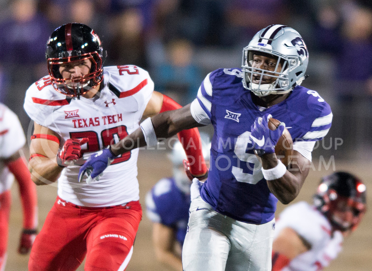 Sophomore wide receiver Byron Pringle avoids Texas Tech fullback Mason Reed during the game between K-State and Texas Tech on Oct. 8, 2016, in Bill Snyder Family Stadium. (George Walker | The Collegian)