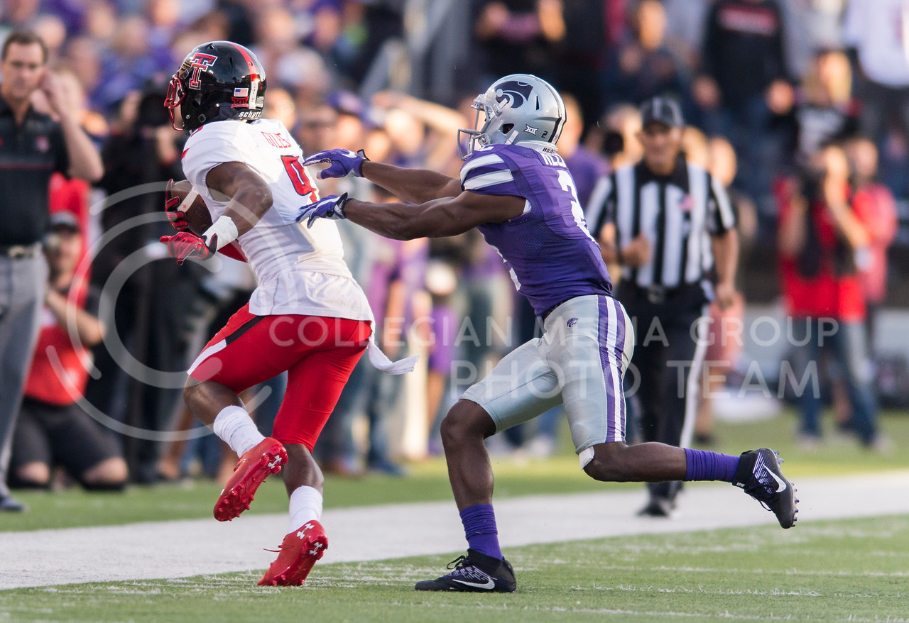 Sophomore defensive back D.J. Reed pushes Texas Tech wide receiver Jonathan Giles out of bounds during the game between K-State and Texas Tech on Oct. 8, 2016, in Bill Snyder Family Stadium. (George Walker | The Collegian)