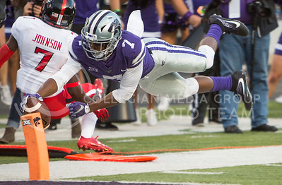 Freshman wide receiver Isiah Zuber hits the pylon with the ball for a touchdown during the football game between K-State and Texas Tech on Oct. 8, 2016, in Bill Snyder Family Stadium. (Emily Starkey | The Collegian)