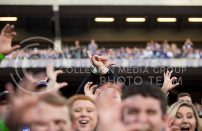 A K-State fan makes the Texas Tech hand sign during the football game between K-State and TTU on Oct. 8, 2016, in Bill Snyder Family Stadium. (Emily Starkey | The Collegian)