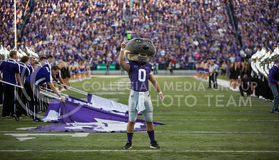 Willie points to the sky as the K-State football team prepares to take the field for the football game between K-State and Texas Tech on Oct. 8, 2016, in Bill Snyder Family Stadium. (Emily Starkey | The Collegian)