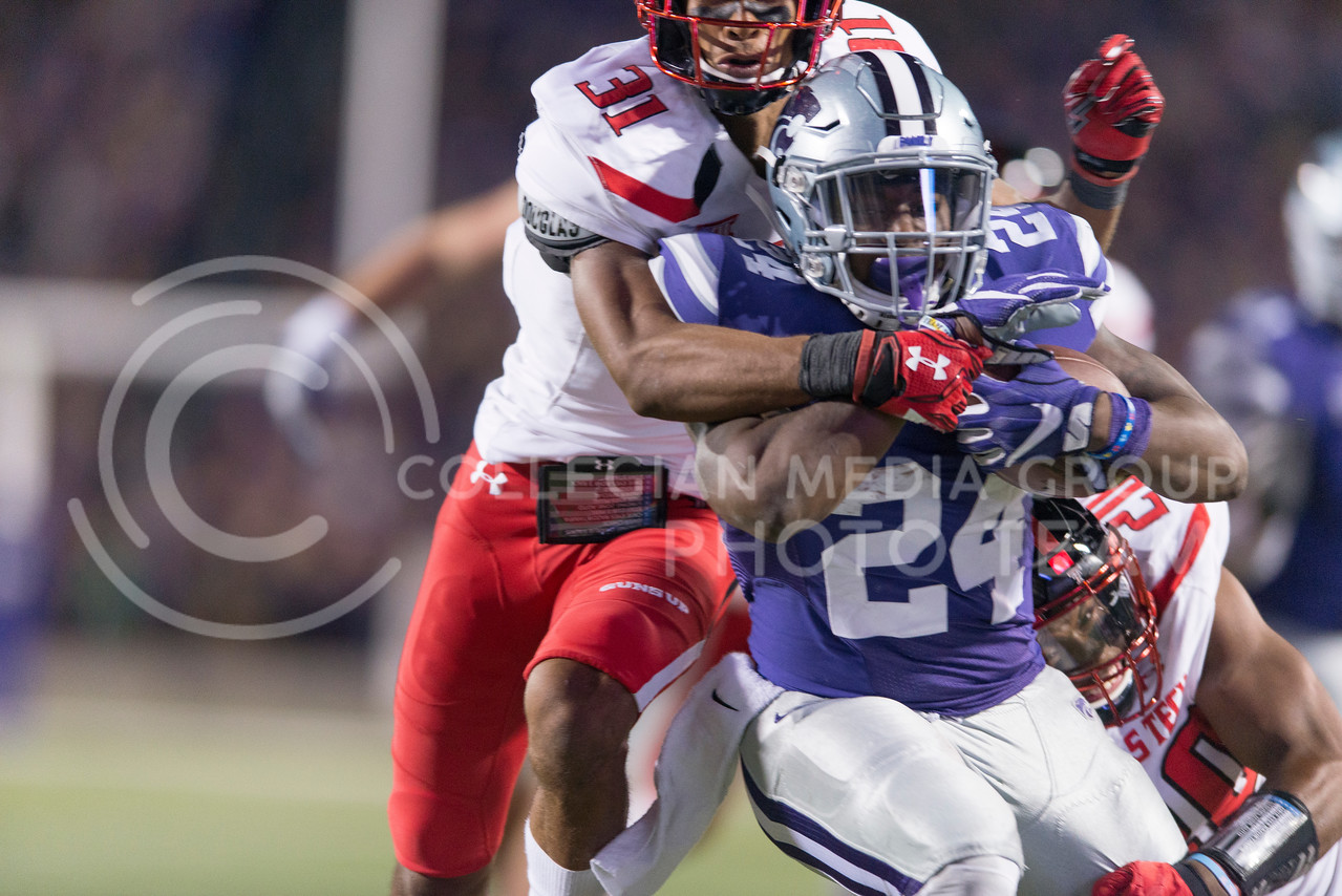 Senior running back Charles Jones is tackled by Texas Tech defensive back Justis Nelson during the game between K-State and Texas Tech on Oct. 8, 2016, in Bill Snyder Family Stadium. (George Walker | The Collegian)