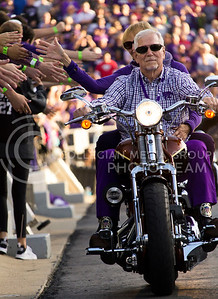 A K-State fan rides a motorcycle during Harley Day in Bill Snyder Family Stadium on Oct. 8, 2016. (Hallie Lucas | The Collegian)