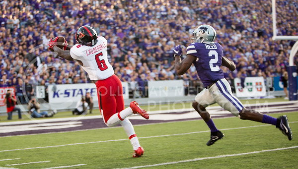 Texas Tech wide receiver reaches for a ball as K-State sophomore defensive back D.J. Reed trails behind during the football game between KSU and TTU on Oct. 8, 2016, in Bill Snyder Family Stadium. (Emily Starkey | The Collegian)