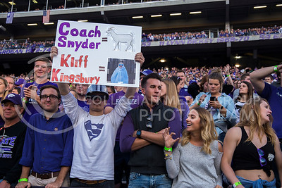 A fan holds a sign during the K-State against Texas Tech football game in Bill Snyder Family Stadium on Oct. 8, 2016. (Anna Spexarth | The Collegian)