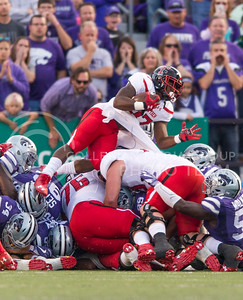 Texas Tech running back Demarcus Felton jumps over players during the game between K-State and Texas Tech on Oct. 8, 2016, in Bill Snyder Family Stadium. (George Walker | The Collegian)