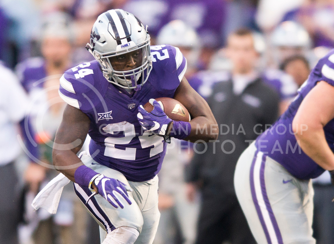 Senior running back Charles Jones takes the ball downfield during the game between K-State and Texas Tech on Oct. 8, 2016, in Bill Snyder Family Stadium. (George Walker | The Collegian)