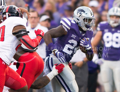 Senior running back Charles Jones pushes against a Texas Tech tackle during the game between K-State and Texas Tech on Oct. 8, 2016, in Bill Snyder Family Stadium. (George Walker | The Collegian)