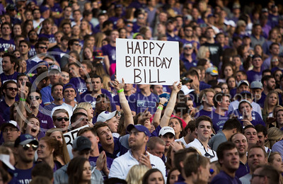 "K-State fans hold a ""happy birthday Bill"" sign, celebrating head coach Bill Snyder's birthday during the football game between KSU  and Texas Tech on Oct. 8, 2016, in Bill Snyder Family Stadium. (Emily Starkey 