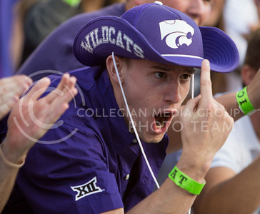 John Poorman, junior in management, cheers on the Wildcats during the football game between K-State and Texas Tech on Oct. 8, 2016, in Bill Snyder Family Stadium. (Emily Starkey | The Collegian)
