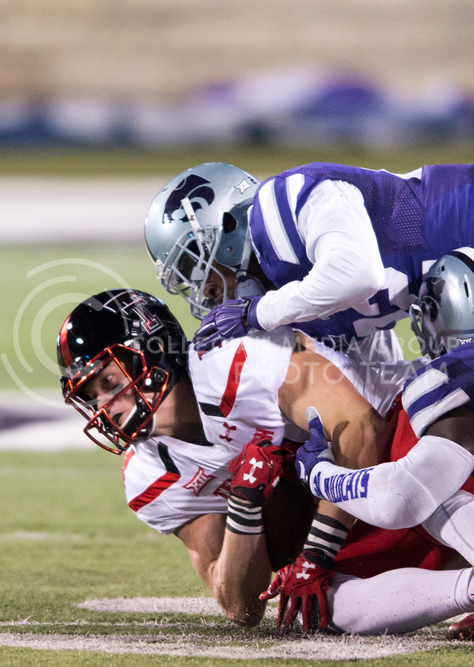 Junior wide receiver Dylan Cantrell is tackled by K-State during the game between K-State and Texas Tech on Oct. 8, 2016, in Bill Snyder Family Stadium. (George Walker | The Collegian)