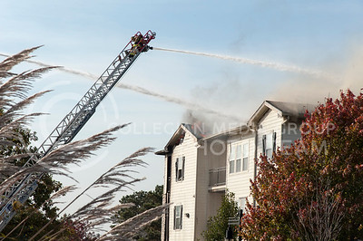 Manhattan Fire Department works to put out flames of a building fire at Founders Hill on Oct. 17, 2016. (Evert Nelson | The Collegian)