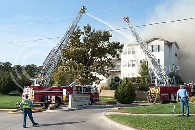 Building G of Founders Hill apartment home burns as firefighters attempt to put out the blaze on Oct. 17, 2016. (Evert Nelson | The Collegian)