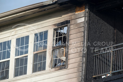 Damage to building G of Founders Hill apartment complex is visible as firefighters work to put out a fire at the complex in Manhattan, Kansas, on Oct. 17, 2016. (George Walker | The Collegian)