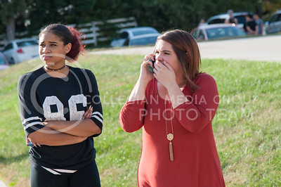 Crissy (right) reacts with Brianna (left) while a fire burns through building G of Founders Hill apartment complex on Oct. 17, 2016. (Evert Nelson | The Collegian)