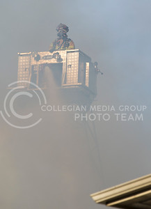 Firefighters work to put out a fire at Founders Hill Apartments in Manhattan, Kansas, on Oct. 17, 2016. (George Walker | The Collegian)