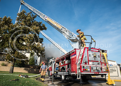 Firefighters work to put out a fire at Founders Hill Apartments in Manhattan, Kansas, on Oct. 17, 2016. (Austin Fuller | The Collegian)