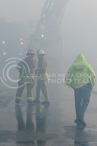 The Manhattan Fire Department works with Riley County Police Department to secure the scene while building G of Founders Hill Apartments burns on Oct. 17, 2016. (Evert Nelson | The Collegian)