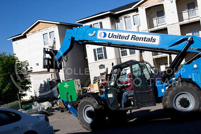 A construction workers drives a forklift to carry wooden boards to be enstall in the burnt building at Founder's Hills appartemnt complex at April. 27, 2017. (Alanud Alanazi | The Collegian)