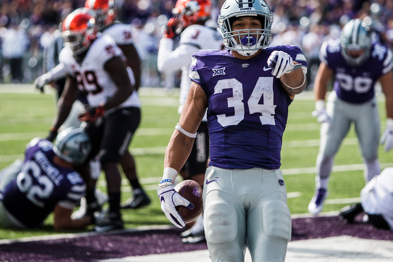 Junior running back Alex Barnes celebrates after scoring a touchdown in K-State's football game against Oklahoma State in Bill Snyder Family Stadium on Oct. 13, 2018. The Wildcats defeated the Cowboys 31-12. (Logan Wassall | Collegian Media Group)