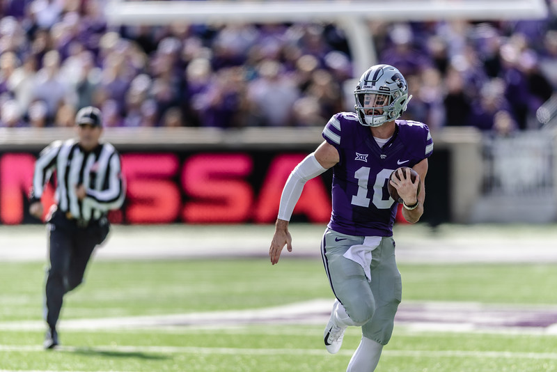Wildcat sophomore quarterback Skylar Thompson runs the ball towards a first down advancing the Wildcats farther into the territory of the Cowboys. On Saturday, the Kansas State Wildcats faced off against the Oklahoma State Cowboys and won with a final score of 31-12 at Bill Snyder Family Stadium. (Olivia Bergmeier | Collegian Media Group)
