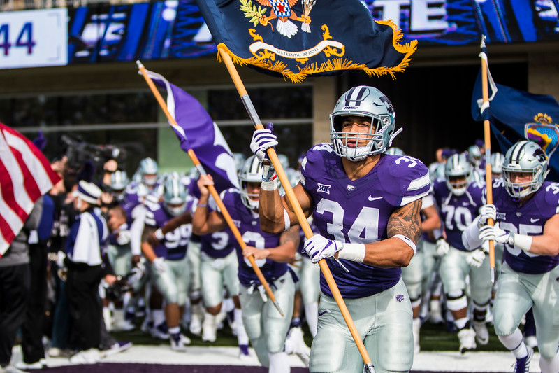 Junior running back Alex Barnes runs out on the field with the rest of his team minutes before kickoff in their football game against Oklahoma State in Bill Snyder Family Stadium on Oct. 13, 2018. The Wildcats defeated the Cowboys 31-12. (Logan Wassall | Collegian Media Group)