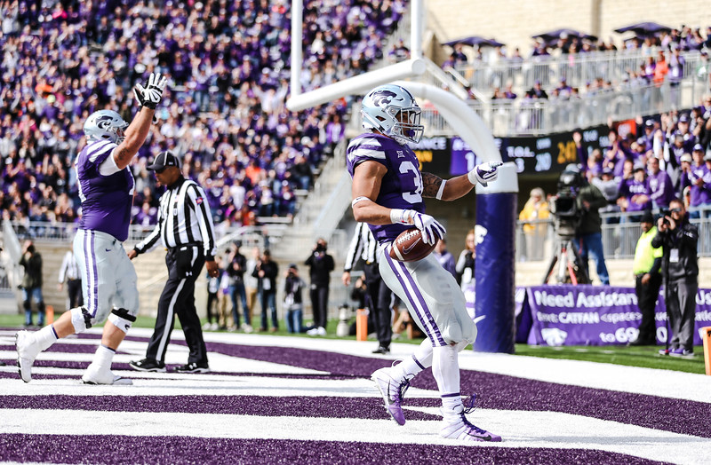 Alex Barnes celebrates making a touchdown during the K-State football game against Oklahoma State in Bill Snyder Family Stadium on Oct. 13, 2018. The Wildcats defeated the Cowboys 31-12. (Emily Lenk | Collegian Media Group)