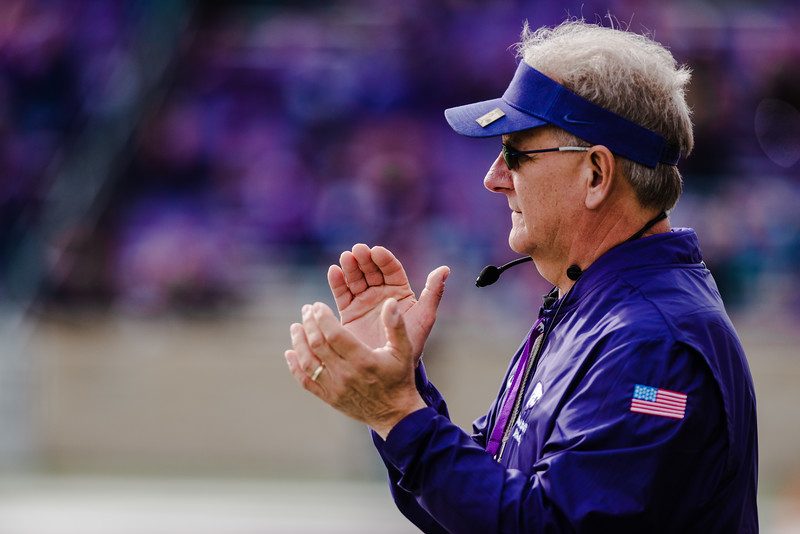 K-State band director Frank Tracz applauds his band during their pregame performance at the K-State football game against Oklahoma State in Bill Snyder Family Stadium on Oct. 13, 2018. The Wildcats defeated the Cowboys 31-12. (Meg Shearer | Collegian Media Group)
