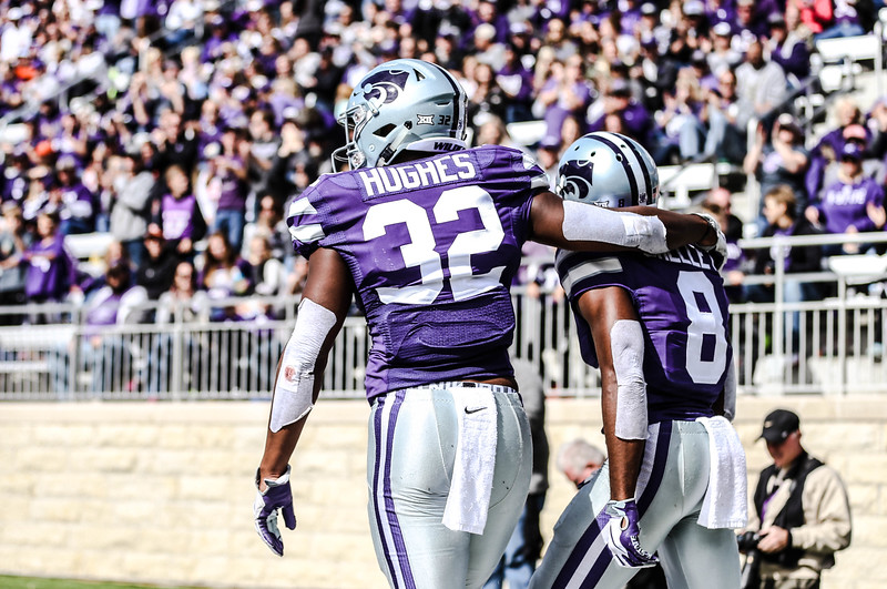 K-State Wildcats, Shelley and Hughes, walk off the field during the football game against Oklahoma State in Bill Snyder Family Stadium on Oct. 13, 2018. The Wildcats defeated the Cowboys 31-12. (Emily Lenk | Collegian Media Group)