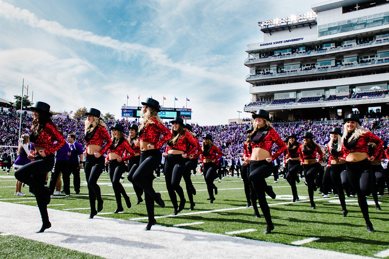 K-State cheerleaders dance during their half-time performance at the K-State football game against Oklahoma State in Bill Snyder Family Stadium on Oct. 13, 2018. The Wildcats defeated the Cowboys 31-12. (Meg Shearer | Collegian Media Group)