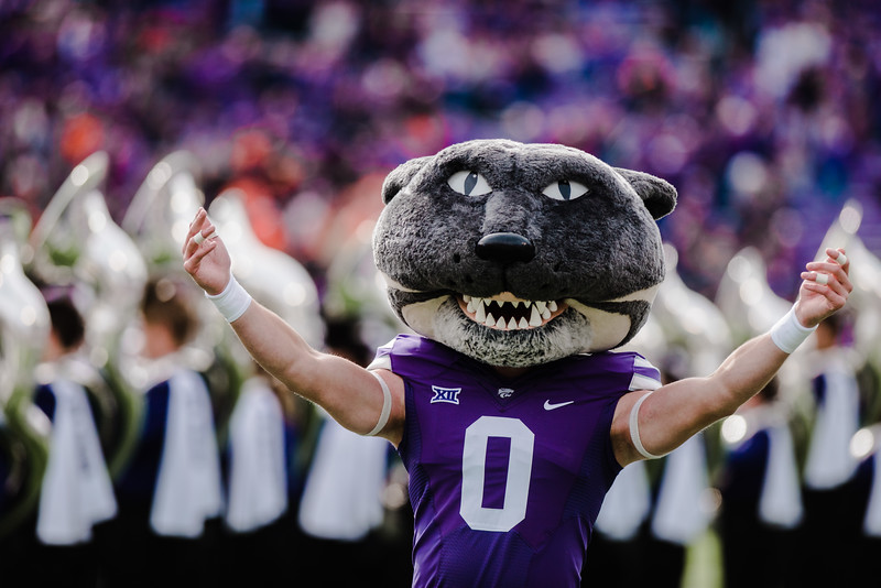 Willie the Wildcat welcomes the football players before the K-State football game against Oklahoma State in Bill Snyder Family Stadium on Oct. 13, 2018. The Wildcats defeated the Cowboys 31-12. (Meg Shearer | Collegian Media Group)