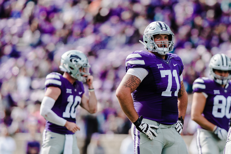 Offensive lineman Dalton Risner watches the replay screen at the K-State football game against Oklahoma State in Bill Snyder Family Stadium on Oct. 13, 2018. The Wildcats defeated the Cowboys 31-12. (Meg Shearer | Collegian Media Group)