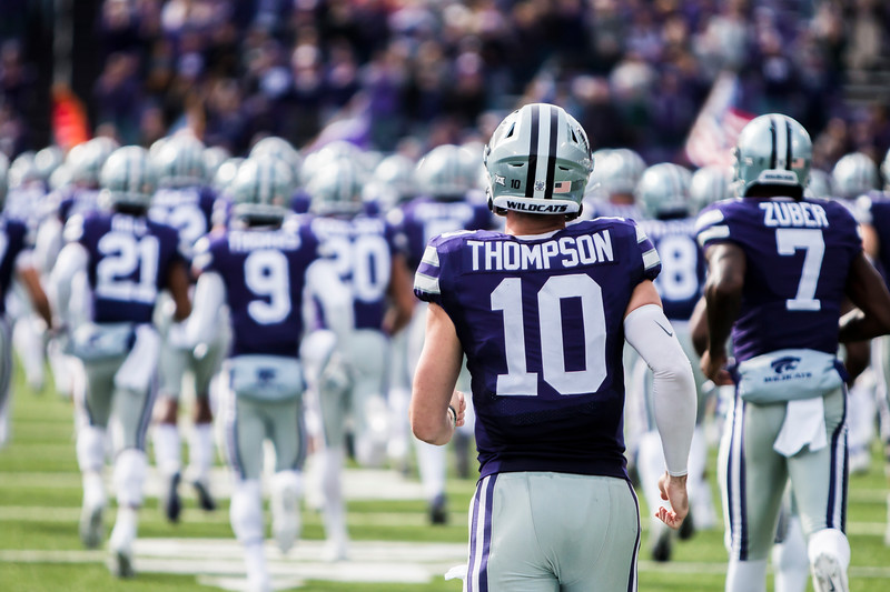 Sophomore Quarterback Skyler Thompson runs out on the field with the rest of his team minutes before kickoff in their football game against Oklahoma State in Bill Snyder Family Stadium on Oct. 13, 2018. The Wildcats defeated the Cowboys 31-12. (Logan Wassall | Collegian Media Group)