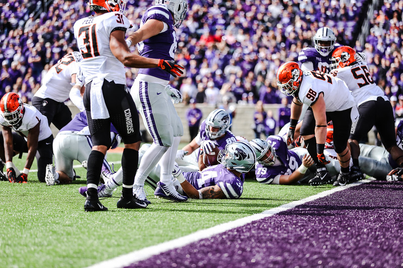 Alex Barnes holds onto the ball after a tackle during the K-State football game against Oklahoma State in Bill Snyder Family Stadium on Oct. 13, 2018. The Wildcats defeated the Cowboys 31-12. (Emily Lenk | Collegian Media Group)