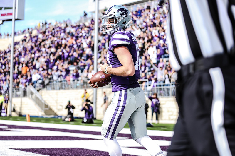 Reuter carries the ball back onto the field during the football game against Oklahoma State in Bill Snyder Family Stadium on Oct. 13, 2018. The Wildcats defeated the Cowboys 31-12. (Emily Lenk | Collegian Media Group)
